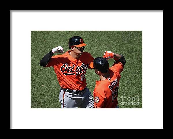 People Framed Print featuring the photograph Manny Machado and Chris Davis by Tom Szczerbowski