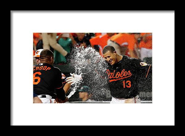 People Framed Print featuring the photograph Manny Machado and Jonathan Schoop by Rob Carr