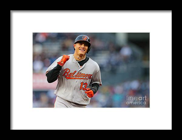 Three Quarter Length Framed Print featuring the photograph Manny Machado and Matt Wieters by Mike Stobe