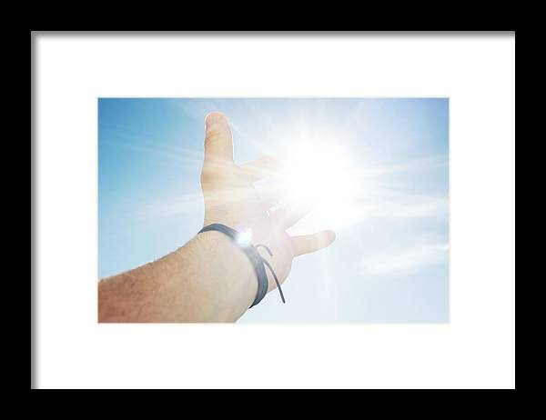 People Framed Print featuring the photograph Mans hand reaching for sun by Hup