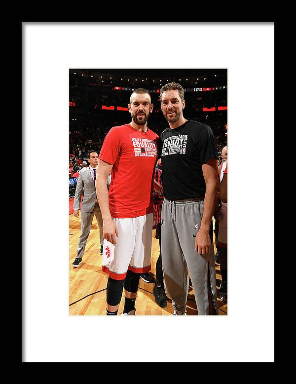Nba Pro Basketball Framed Print featuring the photograph Marc Gasol and Pau Gasol by Ron Turenne