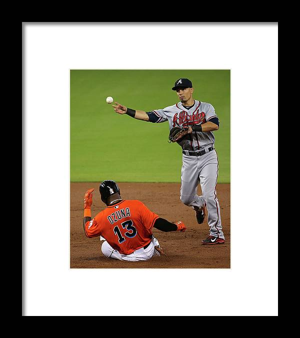 Double Play Framed Print featuring the photograph Marcell Ozuna and Jace Peterson by Mike Ehrmann