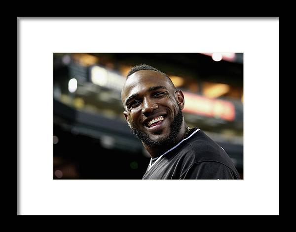 National League Baseball Framed Print featuring the photograph Marcell Ozuna by Christian Petersen