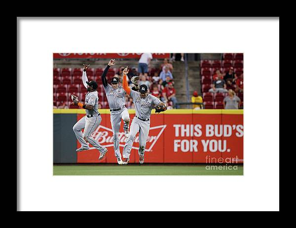 Great American Ball Park Framed Print featuring the photograph Marcell Ozuna, Christian Yelich, and Giancarlo Stanton by Joe Robbins