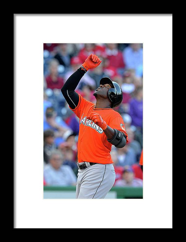 American League Baseball Framed Print featuring the photograph Marcell Ozuna by Greg Fiume
