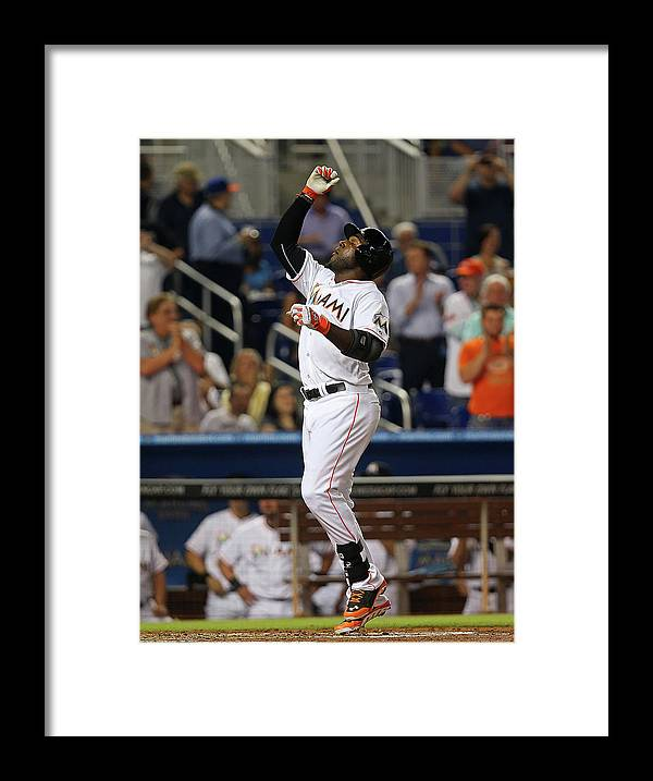 American League Baseball Framed Print featuring the photograph Marcell Ozuna by Mike Ehrmann