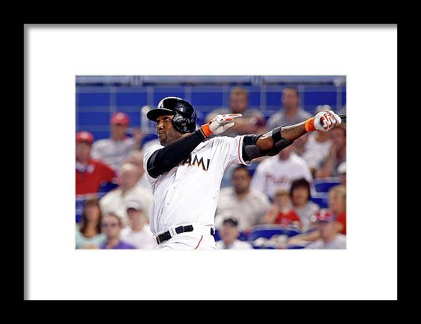 American League Baseball Framed Print featuring the photograph Marcell Ozuna by Rob Foldy