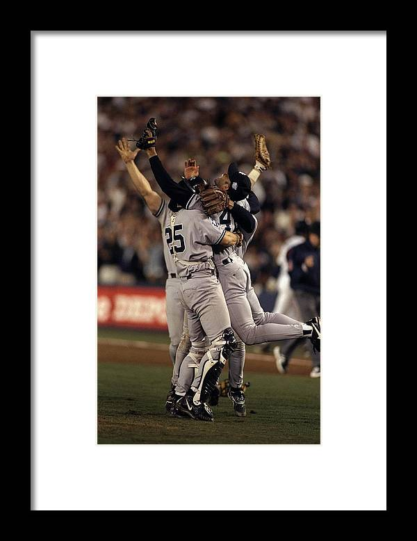 Following Framed Print featuring the photograph Mariano Rivera and Joe Girardi by Al Bello