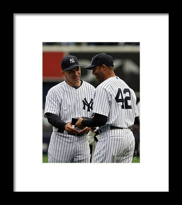 People Framed Print featuring the photograph Mariano Rivera and Joe Girardi by Chris Trotman