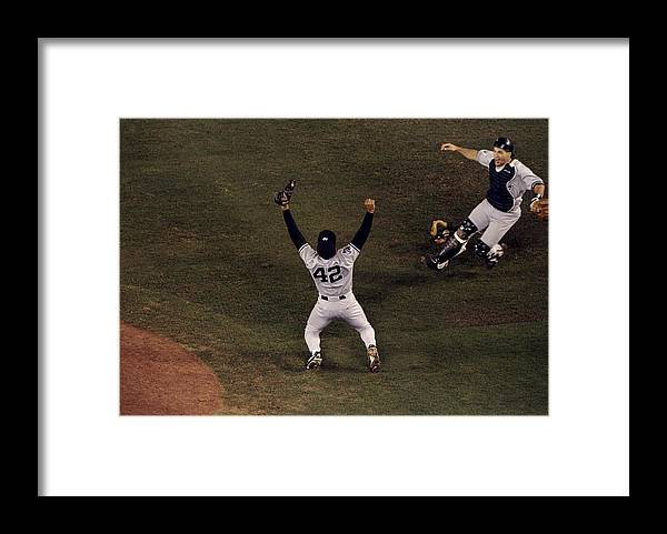 Following Framed Print featuring the photograph Mariano Rivera and Joe Girardi by Todd Warshaw