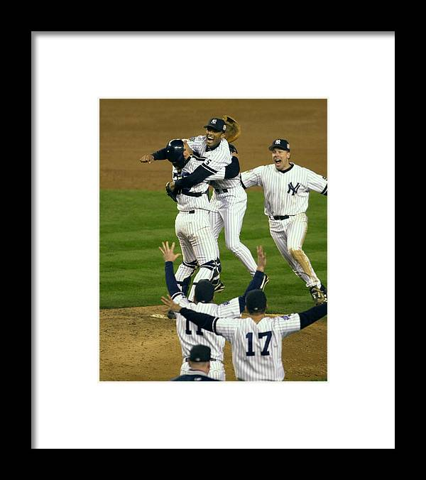 Baseball Catcher Framed Print featuring the photograph Mariano Rivera, Scott Brosius, and Jorge Posada by New York Daily News Archive