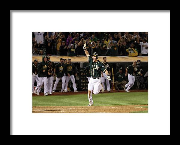 People Framed Print featuring the photograph Mark Canha and Billy Butler by Ezra Shaw