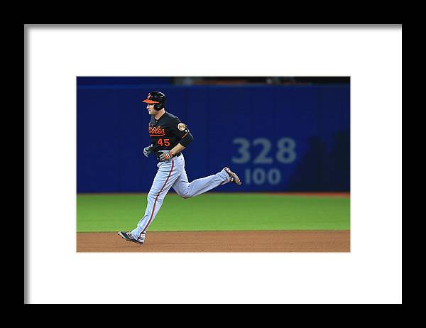 Playoffs Framed Print featuring the photograph Mark Trumbo by Vaughn Ridley