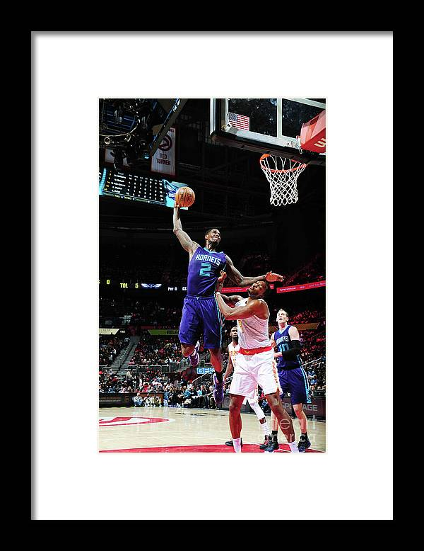 Atlanta Framed Print featuring the photograph Marvin Williams and Dwight Howard by Scott Cunningham