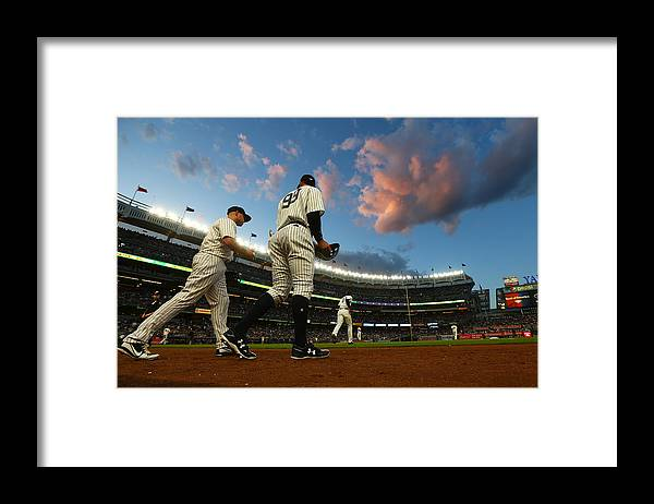 Second Inning Framed Print featuring the photograph Matt Holliday and Aaron Judge by Mike Stobe