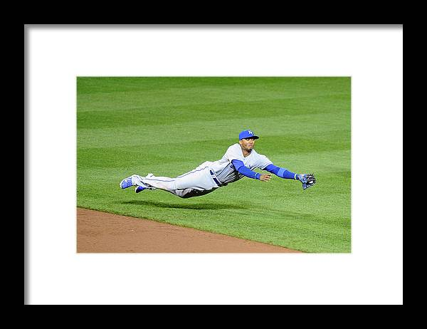 American League Baseball Framed Print featuring the photograph Matt Wieters and Alcides Escobar by Greg Fiume