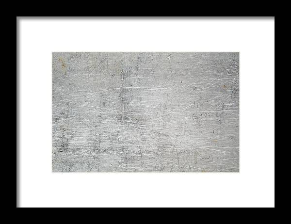 Material Framed Print featuring the photograph Metallic surface scratched and stained by Flavio Coelho