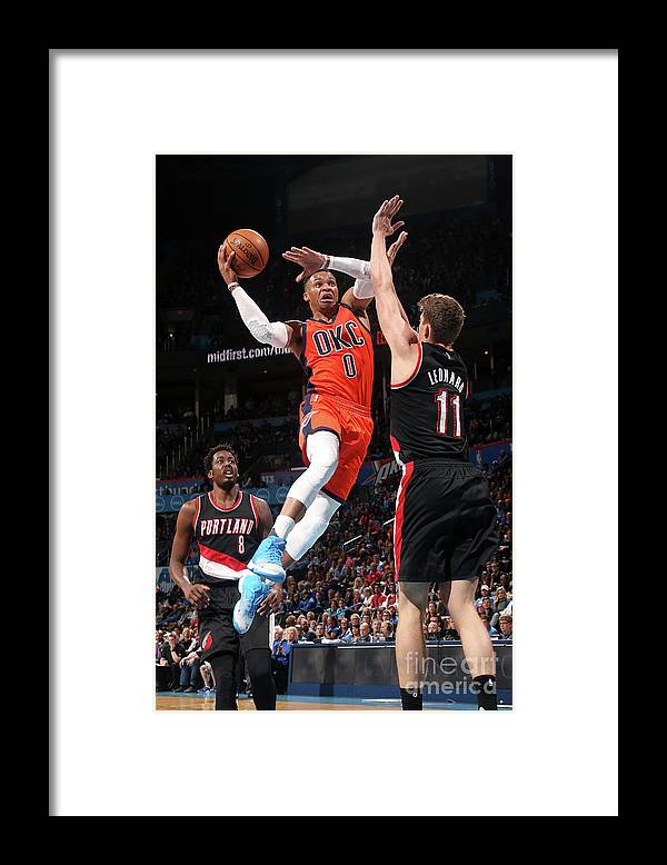 Meyers Leonard Framed Print featuring the photograph Meyers Leonard and Russell Westbrook by Layne Murdoch