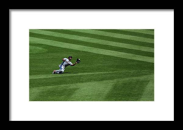 People Framed Print featuring the photograph Michael Bourn and Alex Gordon by Ed Zurga