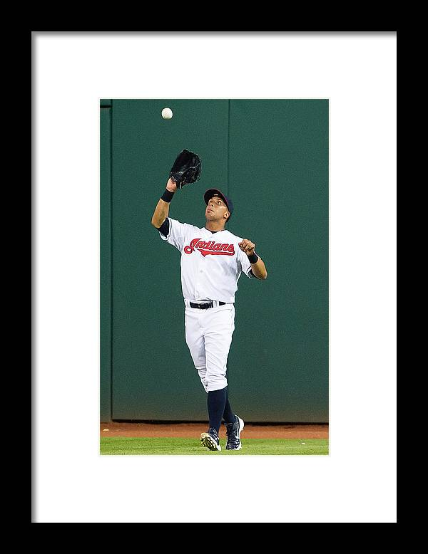 People Framed Print featuring the photograph Michael Brantley and Carlos Correa by Jason Miller