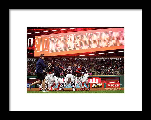 People Framed Print featuring the photograph Michael Brantley And Francisco Lindor by David Maxwell