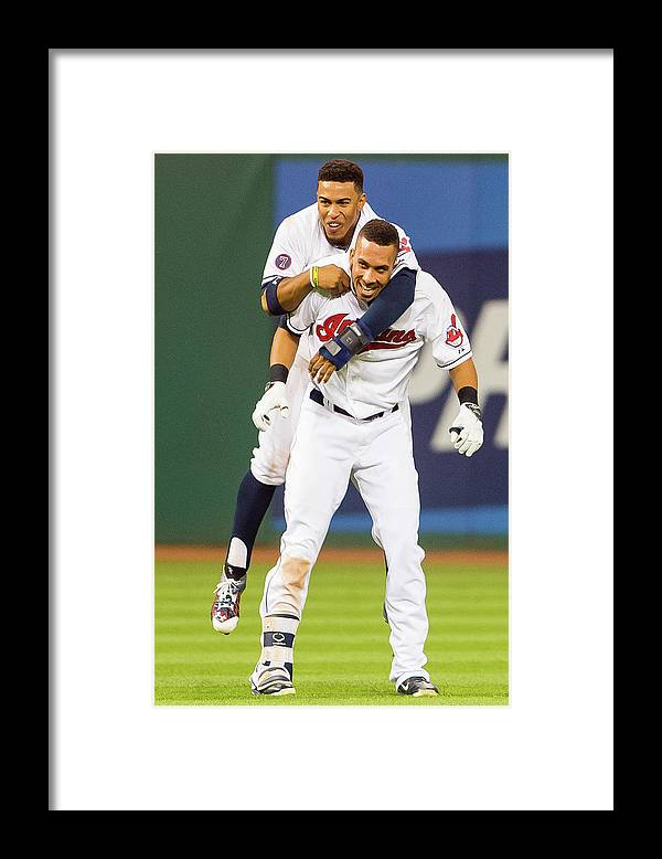 People Framed Print featuring the photograph Michael Brantley and Francisco Lindor by Jason Miller
