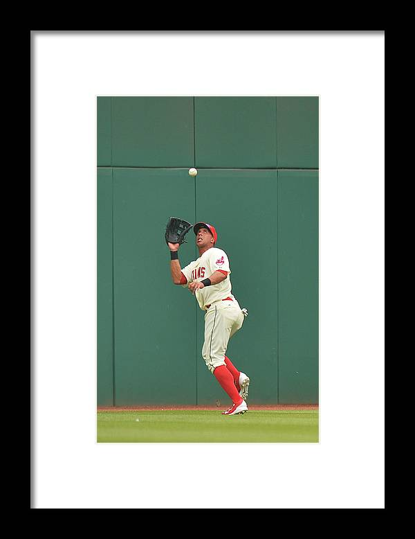 People Framed Print featuring the photograph Michael Brantley and Skip Schumaker by Jamie Sabau