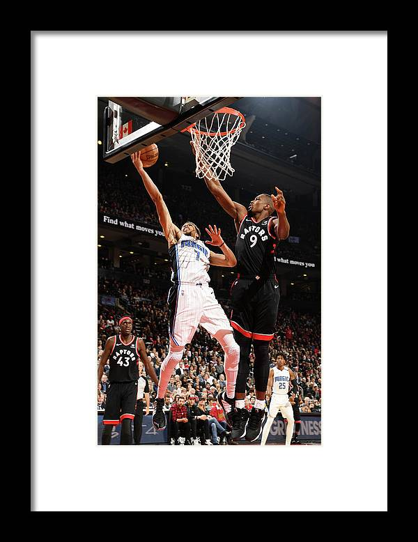 Nba Pro Basketball Framed Print featuring the photograph Michael Carter-williams by Ron Turenne