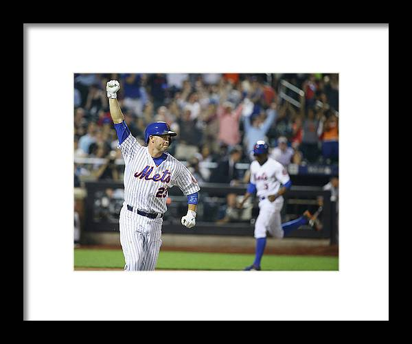 People Framed Print featuring the photograph Michael Cuddyer and Curtis Granderson by Al Bello