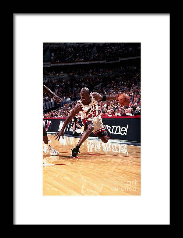 Chicago Bulls Framed Print featuring the photograph Michael Jordan by Barry Gossage