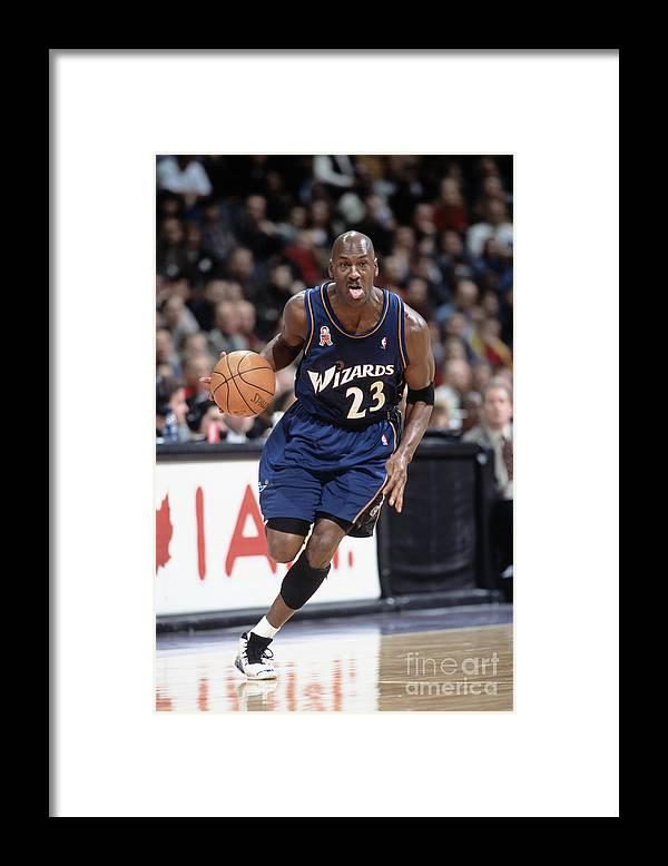 Nba Pro Basketball Framed Print featuring the photograph Michael Jordan by Ron Turenne