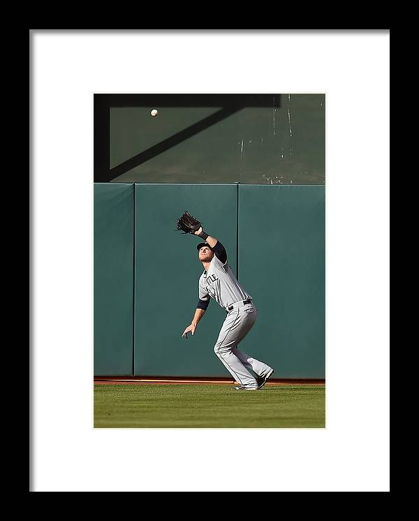 Game Two Framed Print featuring the photograph Michael Saunders and Craig Gentry by Thearon W. Henderson