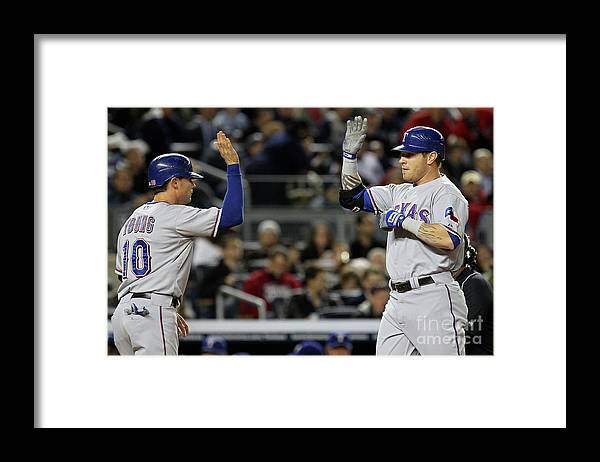 Playoffs Framed Print featuring the photograph Michael Young and Josh Hamilton by Al Bello