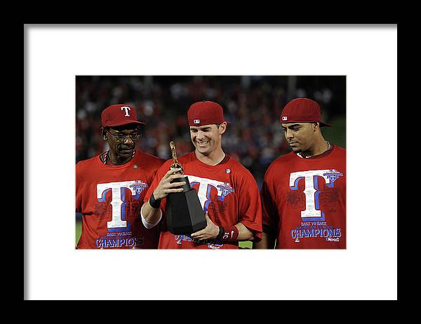 American League Baseball Framed Print featuring the photograph Michael Young, Nelson Cruz, and Ron Washington by Harry How