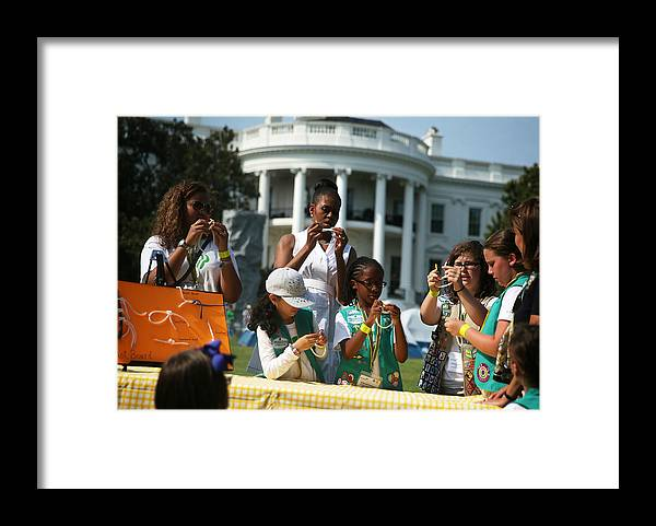 Event Framed Print featuring the photograph Michelle Obama Hosts Girls Scouts At First-Ever White House Campout by Alex Wong