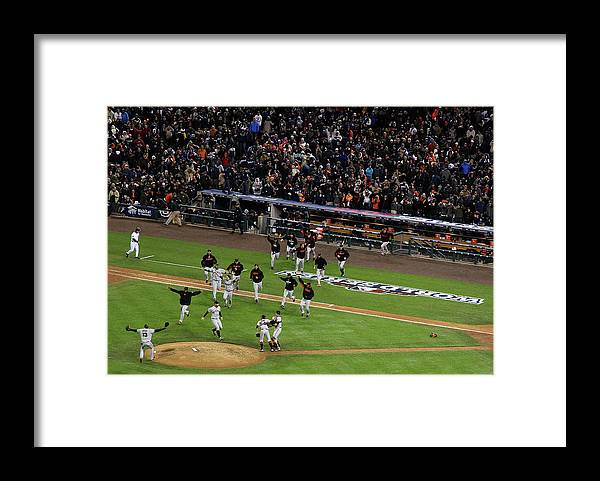 American League Baseball Framed Print featuring the photograph Miguel Cabrera and Sergio Romo by Christian Petersen