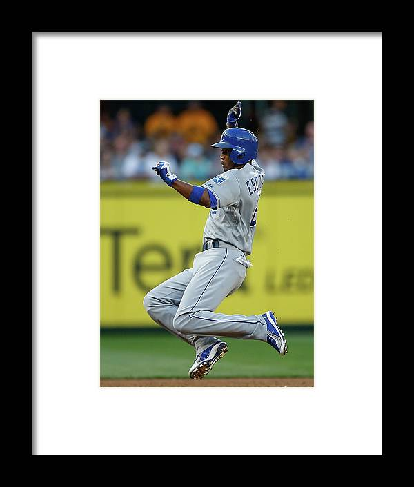 People Framed Print featuring the photograph Mike Moustakas and Alcides Escobar by Otto Greule Jr
