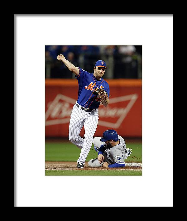Playoffs Framed Print featuring the photograph Mike Moustakas and Daniel Murphy by Brad Mangin