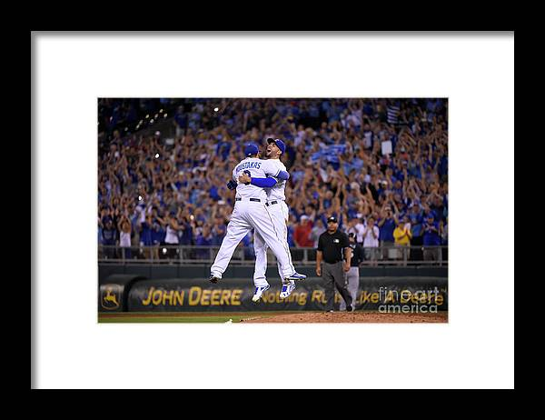 People Framed Print featuring the photograph Mike Moustakas and Eric Hosmer by Ed Zurga