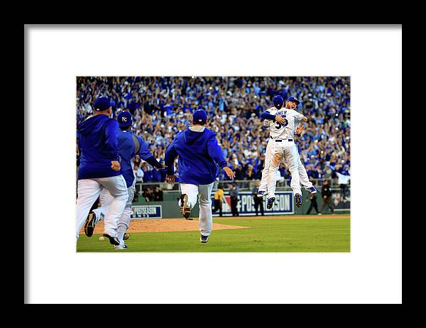 American League Baseball Framed Print featuring the photograph Mike Moustakas and Eric Hosmer by Jamie Squire