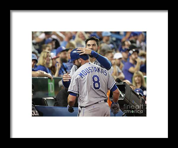 Three Quarter Length Framed Print featuring the photograph Mike Moustakas and Eric Hosmer by Tom Szczerbowski