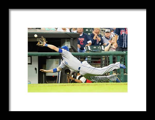 American League Baseball Framed Print featuring the photograph Mike Moustakas and Lonnie Chisenhall by Jason Miller