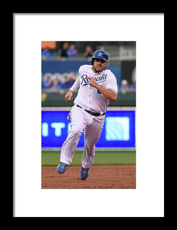 People Framed Print featuring the photograph Mike Moustakas and Lorenzo Cain by Ed Zurga
