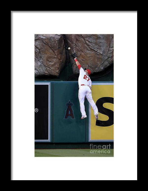 People Framed Print featuring the photograph Mike Moustakas and Mike Trout by Sean M. Haffey