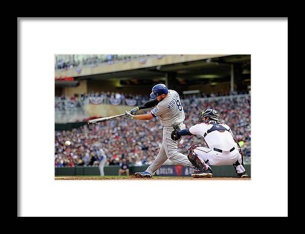 Second Inning Framed Print featuring the photograph Mike Moustakas by Hannah Foslien