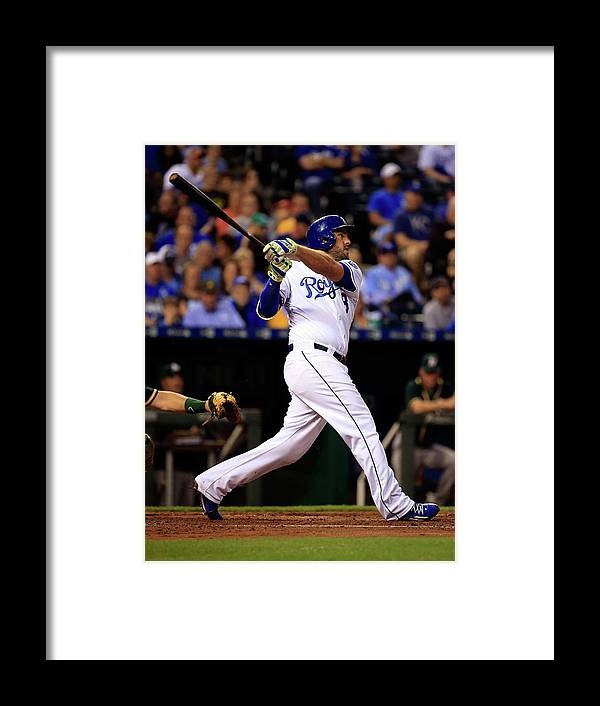 American League Baseball Framed Print featuring the photograph Mike Moustakas by Jamie Squire