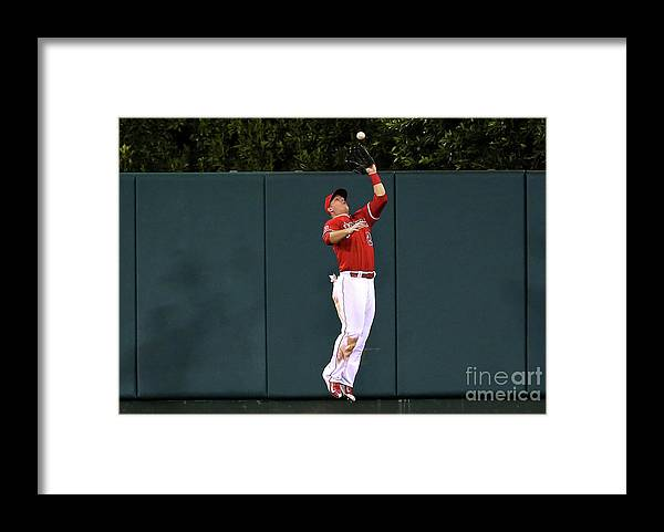 People Framed Print featuring the photograph Mike Trout and Eduardo Escobar by Stephen Dunn