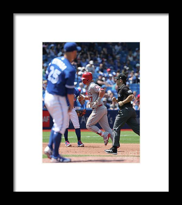 People Framed Print featuring the photograph Mike Trout and Marco Estrada by Tom Szczerbowski
