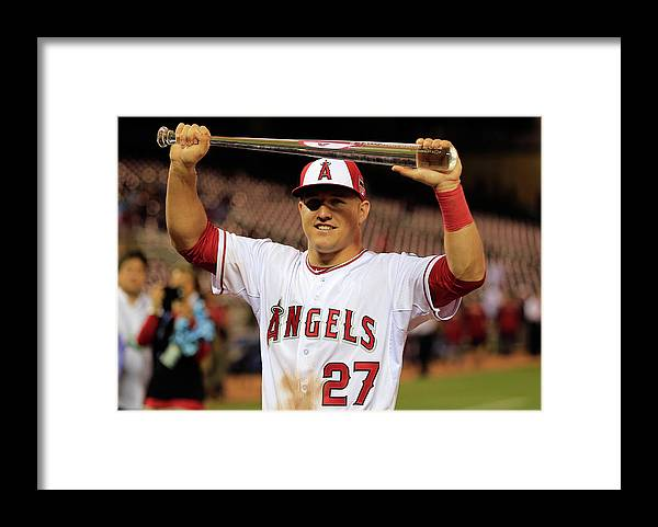 Mike Trout Framed Print featuring the photograph Mike Trout by Rob Carr