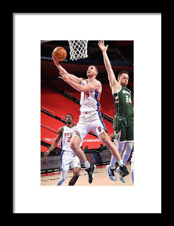 Nba Pro Basketball Framed Print featuring the photograph Milwaukee Bucks v Detroit Pistons by Chris Schwegler